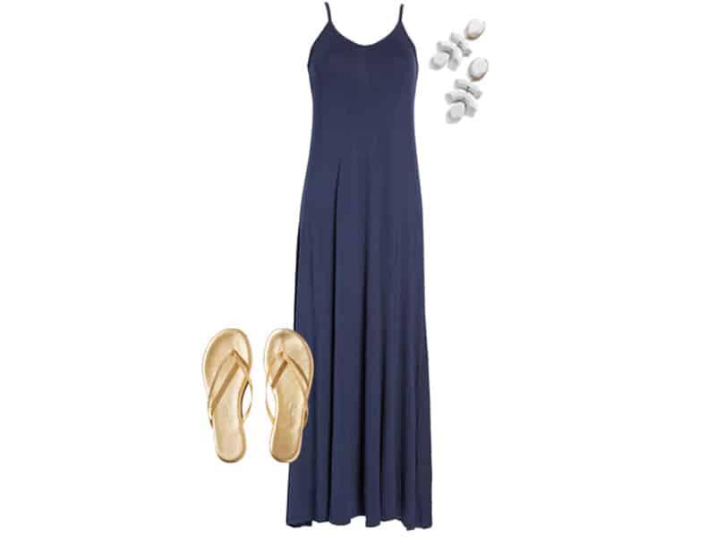 navy maxi dress, gold flip flops, and white earrings